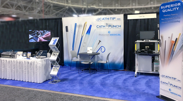 MD&M Minneapolis catheter tipping booth with machines